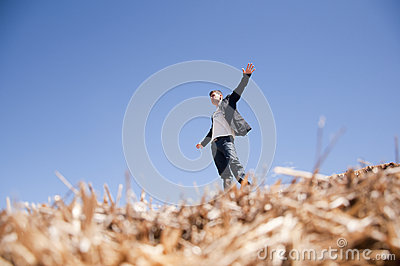 Man on straw bale
