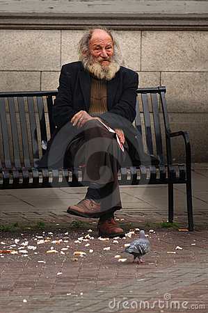 Man on street bench