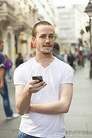 Man on street with mobile phone