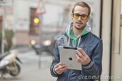 Man On Street Use Ipad Tablet Computer Editorial Photo