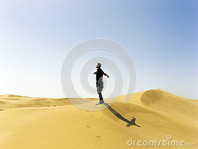 Man stretching in the dunes of Gran Canaria