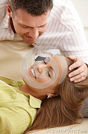 Man stroking woman s hair