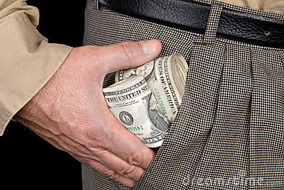 Man stuffing wads of cash into his pocket