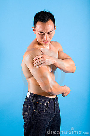 man suffering from pain and discomfort on shoulde