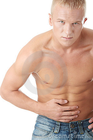 A man suffering in pain in his stomach