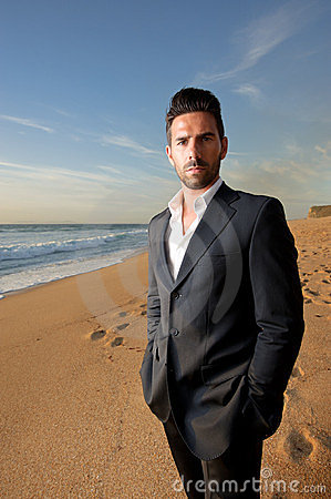 Man in suit at the beach