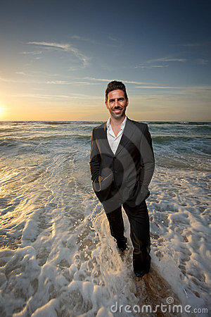 Man in a suit at the beach