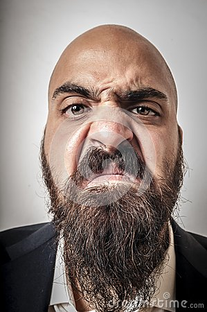 Man with a suit and beard and strange expressions