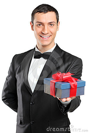 Man in suit and bow tie giving a gift