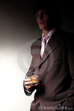 Man in suit with drink