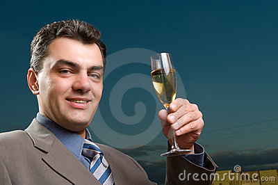 Man in a suit with a glass of champagne