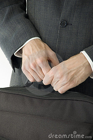 Man in suit holding laptop case