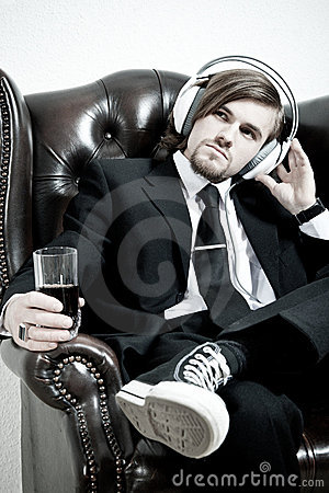 Man In A Suit  Listen To The Music Royalty Free Stock Photos - Image: 21279888