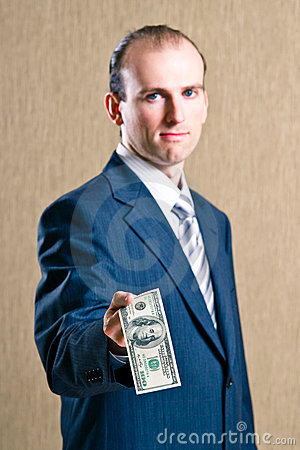 A man in a suit with money
