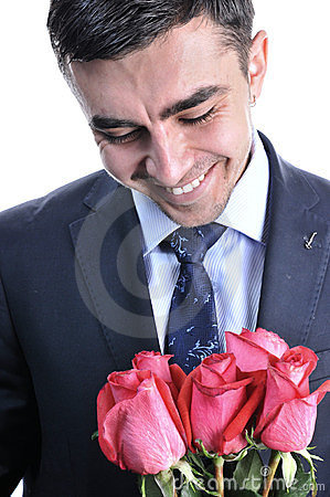 A man in a suit with a rose.