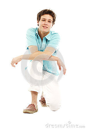 Man with summer beach style kneeling down