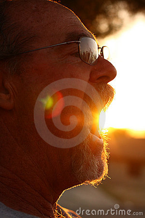 Man with sun coming out of mouth