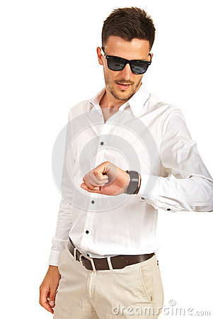 Man with sunglasses checking time