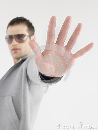 Man In Sunglasses Gesturing Stop Sign