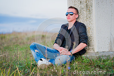 Man in sunglasses relaxing on nature