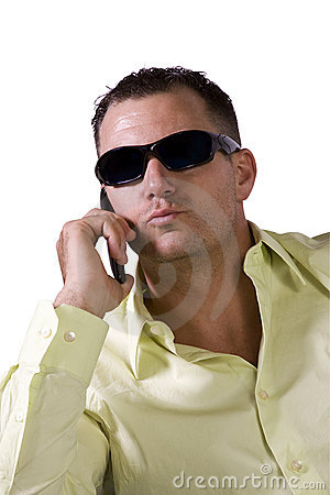 Man with sunglasses talking on cell phone