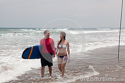 Man with surf and the girl
