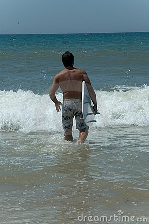 Man with surfboard in sea