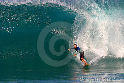 A Man Surfing a Blue Wave in Hawaii Editorial Photography