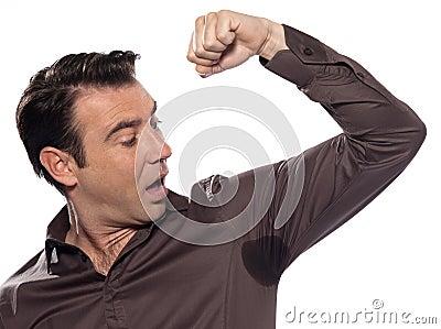 Man surprised looking at sweat stain perspiring