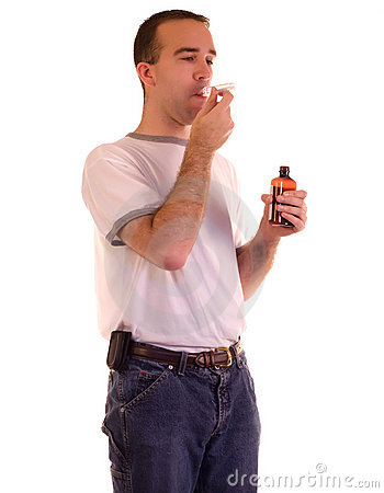 Man Swallowing Medicine