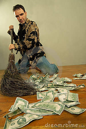 Man sweeping dollar banknotes