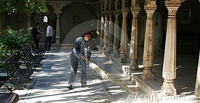 Man sweeping floor Editorial Photo