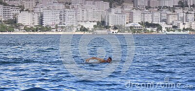 Man Swimming In A Body Of Water White Concrete High Rise Building In Background Free Public Domain Cc0 Image