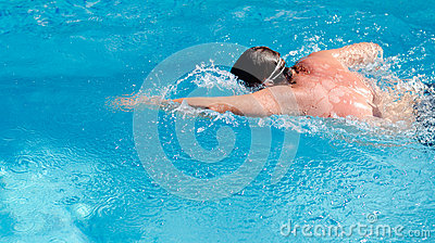 Man swimming in a pool doing the crawl