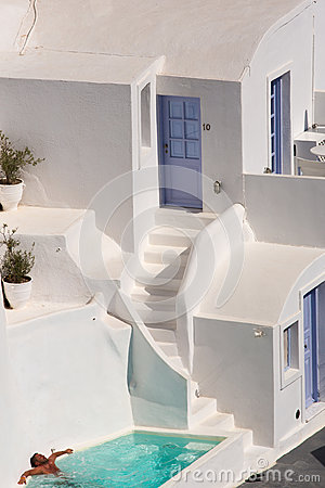 Man in a swimming pool in Santorini Editorial Photo
