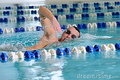 Man swims using the crawl stroke