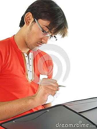 Man takes notes in folder