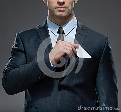 Man takes out white card from the pocket