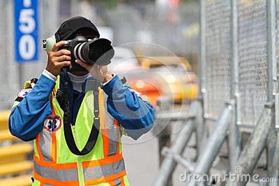 A man takes a photograph