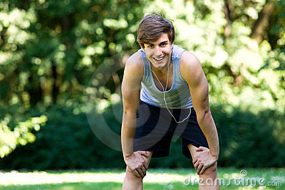 Man taking break from jogging