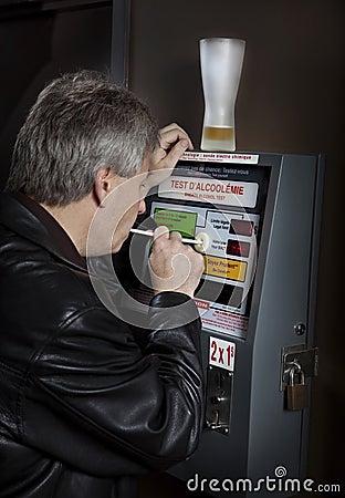 Man taking breathalyzer test