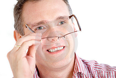 Man taking off glasses