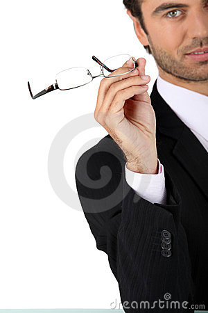 Free Man Taking Off His Glasses Stock Image - 23492491