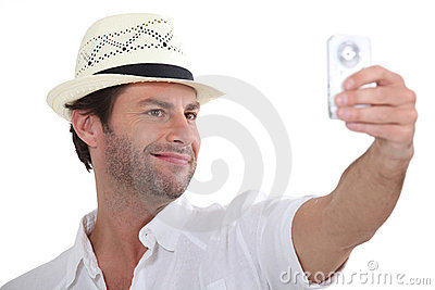 Man taking photo of himself
