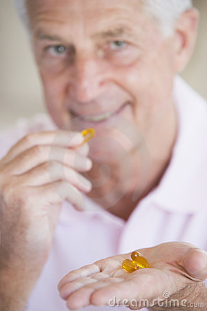 Man Taking Pills