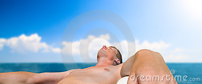 Man taking sunbathe