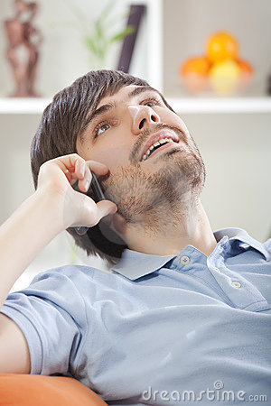 Man talking on phone at home