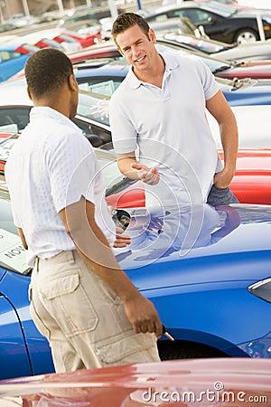 Man talking to car salesman
