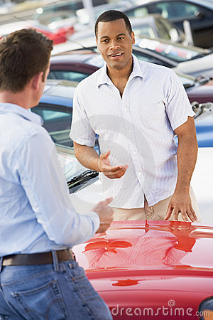 Man talking to car salesman