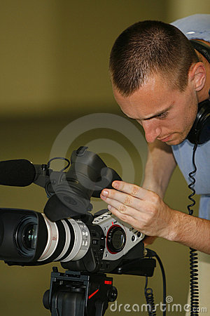 Free Man Taping With Video Camera Royalty Free Stock Images - 2635249